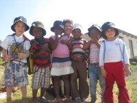 Charlene and the children with their new Nike bags and sunhats